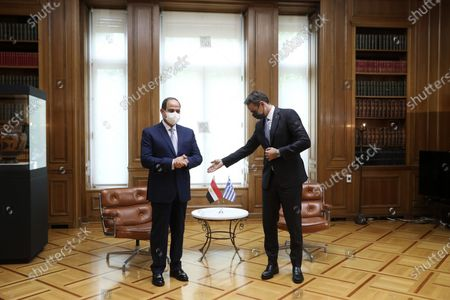 Greece's Prime Minister Kyriakos Mitsotakis, right, and the Egyptian President Abdel-Fattah el-Sissi join a meeting at Maximos Mansion in Athens, . Egypt's president is meeting with Greek officials in Athens, on his first visit to the southern European nation since the two countries signed a deal demarcating maritime boundaries between them in the eastern Mediterranean