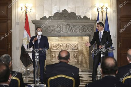 Greek Prime Minister Kyriakos Mitsotakis, right, and Egyptian President Abdel Fattah al-Sisi attend a joint news conference at Maximos Mansion in Athens, . Egypt's president is meeting with Greek officials in Athens on his first visit to the southern European nation since the two countries signed a deal demarcating maritime boundaries between them in the eastern Mediterranean