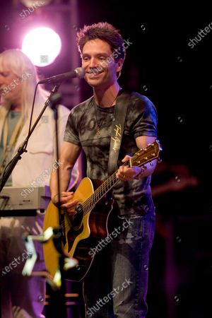 Stock Image of Richard Marx performs with RINGO STARR AND HIS 9th ALL STARR BAND at the Rosemont Theater in Rosemont, IL.