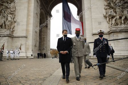 French President Emmanuel Macron (L) speaks with French Armies Chief of Staff General Francois Lecointre (C) during a ceremony at the Arc de Triomphe in Paris, France, 11 November 2020, as part of the commemorations marking the 102nd anniversary of the 11 November 1918 armistice, ending World War I (WWI).
