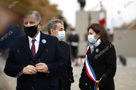(L-R) National Assembly President Richard Ferrand, French former President Nicolas Sarkozy and Paris Mayor Anne Hidalgo attend a ceremony at the Arc de Triomphe in Paris, France, 11 November 2020, as part of the commemorations marking the 102nd anniversary of the 11 November 1918 armistice, ending World War I (WWI).