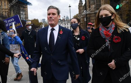 Labour leader Keir Starmer (C) departs a  ceremony at Westminster Abbey in remembrance to Britain's war dead in London, Britain, 11 November 2020. The UK is marking Armistice Day 11 November. Armistice Day is commemorated every year on 11 November to mark the armistice signed between the Allies of World War I and Germany at Compiegne, France at 5:45 am, for the cessation of hostilities on the Western Front of World War I, which took effect at eleven o'clock in the morning. The 'eleventh hour of the eleventh day of the eleventh month' of 1918.