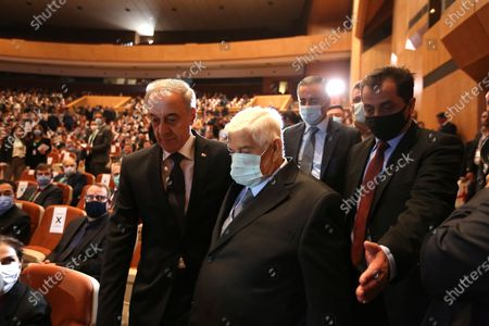 Syrian Foreign Minister Walid al-Moallem (C) arrives to attend the opening session at the International Conference on Return of Syrian Refugees at the Conferences Palace in Damascus, Syria, 11 November 2020. Representatives of 27 countries are taking part in the conference with the aim of putting an end to the suffering of the refugees and to facilitate their return to their homeland.