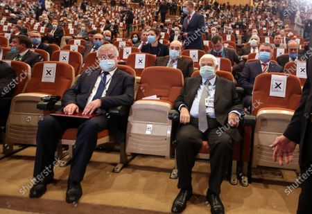 Syrian Foreign Minister Walid al-Moallem (R) and Russian president special envoy Alexander Lavrantiev (L) attend the opening session at the International Conference on Return of Syrian Refugees at the Conferences Palace in Damascus, Syria, 11 November 2020. Representatives of 27 countries are taking part in the conference with the aim of putting an end to the suffering of the refugees and to facilitate their return to their homeland.