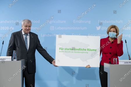 German Minister of Interior, Construction and Homeland Horst Seehofer (L) and German Minister of Food and Agriculture Julia Kloeckner (R) hold a placard reading 'for strong rural areas' during a press conference to present third report of the Federal Government on the development of rural areas at the Federal Ministry of Food and Agriculture in Berlin, Germany, 11 November 2020. German government is supporting rural areas by strengthening infrastructure and volunteerism to promoe cultural offerings and providing a centralised supply of fast Internet access.