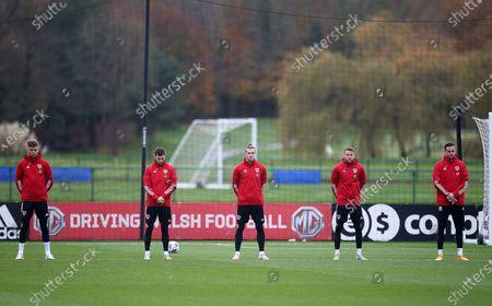 Joe Rodon, Ben Davies, Gareth Bale, Chris Gunter and Daniel Ward respect the two minute silence.