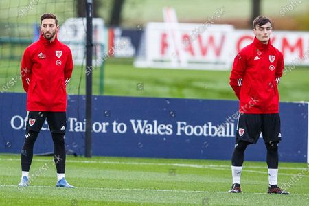 Newport County Midfielder Josh Sheehan (L) and Charlton Athletic Midfielder Dylan Levitt observe a minute's silence for Remembrance Day during the Wales international training session ahead of the friendly match against USA, held at the Vale Resort, Hensol