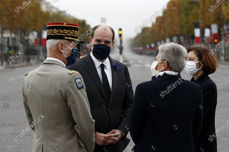 French Prime Minister Jean Castex (2-L) speaks with French Armies Chief of Staff General Francois Lecointre (L), French Junior Defence Minister Genevieve Darrieussecq (2-R) and French Defence Minister Florence Parly (R) as he arrives for a ceremony at the Arc de Triomphe in Paris, France, 11 November 2020, as part of the commemorations marking the 102nd anniversary of the 11 November 1918 armistice, ending World War I (WWI).