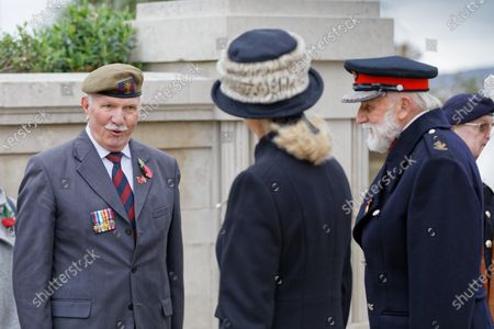 Stock Image of Mrs Roberta Louise Fleet JP, the Lord Lieutenant of West Glamorgan (C) speaks with a former member of the armed forces during Armistice Day at the cenotaph in Swansea
