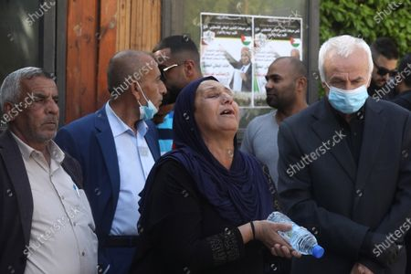 Palestinians attend the funeral of late Palestinian politician and diplomat Saeb Erekat, in the West Bank city of Jericho, 11 November 2020. Erekat, the chief Palestinian negotiator, died on 10 November after contracting the coronavirus disease (COVID-19).
