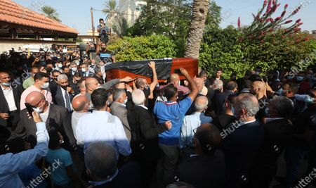 Palestinians carry the coffin of late Palestinian politician and diplomat Saeb Erekat, during his funeral in the West Bank city of Jericho, 11 November 2020. Erekat, the chief Palestinian negotiator, died on 10 November after contracting the coronavirus disease (COVID-19).
