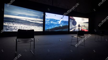 A view of screens displaying artworks by British filmmaker and artist John Akomfrah during the presentation of the exhibition 'Earth is Flat', at Andalusian Contemporary Art Center in Seville, southern Spain, 11 November 2020. The exhibition runs from 13 November to 14 May 2021.