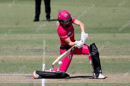 Ellyse Perry of the Sydney Sixers hits the ball during the Women's Big Bash League cricket match between Perth Scorchers and Sydney Sixers