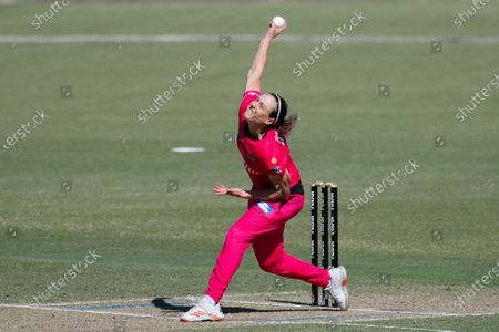 Ellyse Perry of the Sydney Sixers bowls the ball during the Women's Big Bash League cricket match between Perth Scorchers and Sydney Sixers
