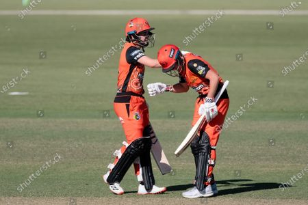 Stock Picture of Heather Graham and Beth Mooney of the Perth Scorchers during the Women's Big Bash League cricket match between Perth Scorchers and Sydney Sixers