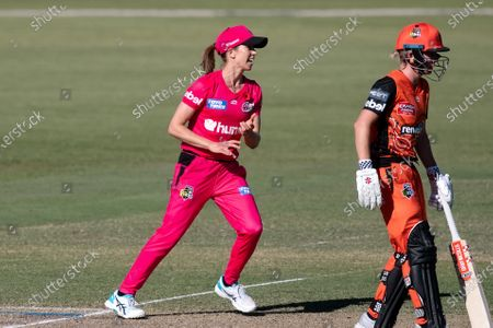 Stock Image of Erin Burns of the Sydney Sixers celebrates the wicket of Heather Graham of the Perth Scorchers during the Women's Big Bash League cricket match between Perth Scorchers and Sydney Sixers