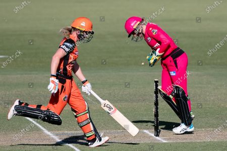Alyssa Healy of the Sydney Sixers runs out Megan Banting of the Perth Scorchers during the Women's Big Bash League cricket match between Perth Scorchers and Sydney Sixers