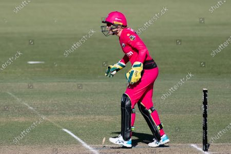 Stock Photo of Alyssa Healy of the Sydney Sixers runs out Megan Banting of the Perth Scorchers during the Women's Big Bash League cricket match between Perth Scorchers and Sydney Sixers