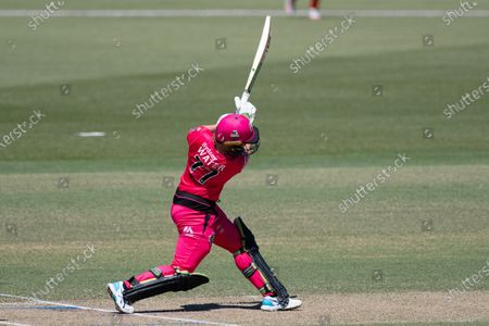 Alyssa Healy of the Sydney Sixers hits the ball during the Women's Big Bash League cricket match between Perth Scorchers and Sydney Sixers