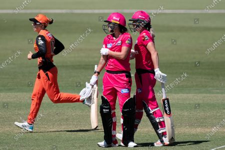 Marizanne Kapp and Ellyse Perry of the Sydney Sixers between overs during the Women's Big Bash League cricket match between Perth Scorchers and Sydney Sixers