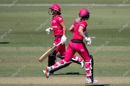 Marizanne Kapp and Ellyse Perry of the Sydney Sixers run between wickets during the Women's Big Bash League cricket match between Perth Scorchers and Sydney Sixers
