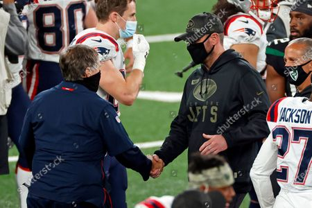 Stock Image of New England Patriots head coach Bill Belichick shakes hands with New York Jets head coach Adam Gase after an NFL football game, in East Rutherford, N.J