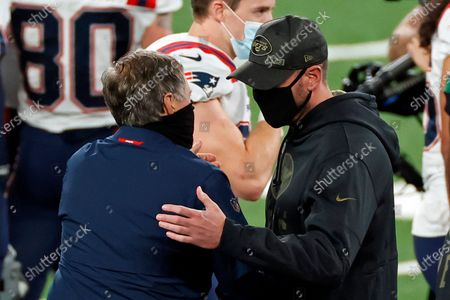 Stock Photo of New England Patriots head coach Bill Belichick shakes hands with New York Jets head coach Adam Gase after an NFL football game, in East Rutherford, N.J