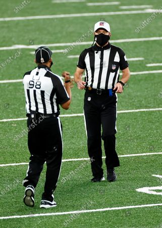 Stock Picture of Referee Alex Kemp (55) talks to line judge Greg Bradley during an NFL football game between the New England Patriots and the New York Jets, in East Rutherford, N.J