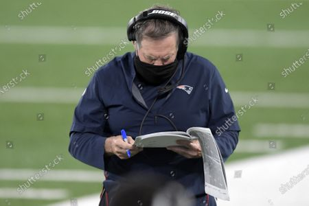 New England Patriots head coach Bill Belichick looks at his charts during the first half of an NFL football game against the New York Jets, in East Rutherford, N.J