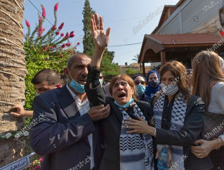 Stock Picture of Neameh Erekat, center, reacts during the funeral of her husband Saeb Erekat in the West Bank city of Jericho, . Erekat, a veteran peace negotiator and prominent international spokesman for the Palestinians for more than three decades, died on Tuesday, weeks after being infected by the coronavirus. He was 65