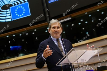 European Commissioner for Budget Johannes Hahn addresses lawmakers during a plenary session at the European Parliament in Brussels
