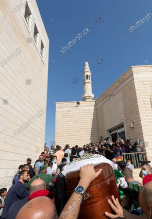 Palestinian honor guard carry the body Saeb Erekat into a mosque during his funeral in the West Bank city of Jericho, . Erekat, a veteran peace negotiator and prominent international spokesman for the Palestinians for more than three decades, died on Tuesday, weeks after being infected by the coronavirus. He was 65