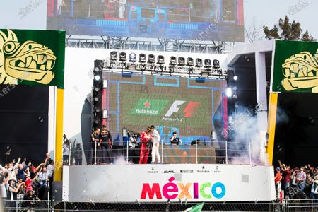 Autodromo Hermanos Rodriguez, Mexico City, Mexico. Sunday 29 October 2017. Top DJ Hardwell arrives on the podium after the celebrations of Max Verstappen, Red Bull, 1st Position, Valtteri Bottas, Mercedes AMG, 2nd Position, and Kimi Raikkonen, Ferrari, 3rd Position, via a revolving backdrop. World Copyright: Sam Bloxham/LAT Images