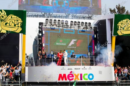Autodromo Hermanos Rodriguez, Mexico City, Mexico. Sunday 29 October 2017. Top DJ Hardwell appears on the podium behind Max Verstappen, Red Bull, 1st Position, Valtteri Bottas, Mercedes AMG, 2nd Position, and Kimi Raikkonen, Ferrari, 3rd Position, after the Champagne is sprayed. World Copyright: Sam Bloxham/LAT Images