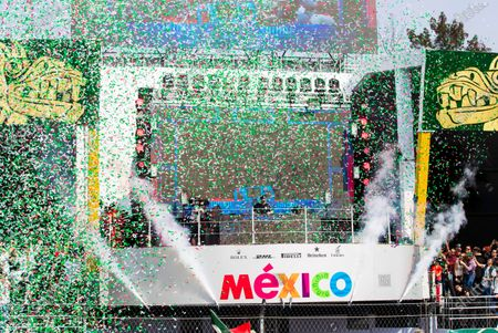Stock Photo of Autodromo Hermanos Rodriguez, Mexico City, Mexico. Sunday 29 October 2017. Top DJ Hardwell appears on the podium behind Max Verstappen, Red Bull, 1st Position, Valtteri Bottas, Mercedes AMG, 2nd Position, and Kimi Raikkonen, Ferrari, 3rd Position, after the Champagne is sprayed. World Copyright: Sam Bloxham/LAT Images