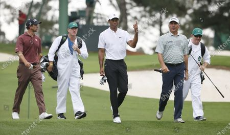 Adam Scott of Australia (L), Tiger Woods of the US (C) and Fred Couples of the US (2R) walk up the fairway after hitting  tee shots on the third hole during the final practice round of the 2020 Masters Tournament at the Augusta National Golf Club in Augusta, Georgia, USA, 11 November 2020. After being delayed seven months by the coronavirus pandemic, the 2020 Masters Tournament is being held without patrons 12 November through 15 November.