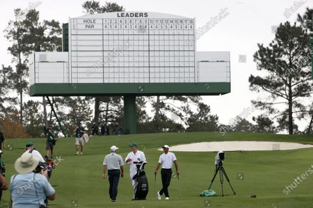 Tiger Woods of the US (R) and Fred Couples of the US (3R) on the tee on the third hole during the final practice round of the 2020 Masters Tournament at the Augusta National Golf Club in Augusta, Georgia, USA, 11 November 2020. After being delayed seven months by the coronavirus pandemic, the 2020 Masters Tournament is being held without patrons 12 November through 15 November.