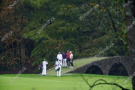 (L-R) Jose Maria Olazabal of Spain, Rafa Cabrera Bello of Spain and Francesco Molinari of Italy pose for a photo on the Hogan Bridge on the twelfth hole during the final practice round of the 2020 Masters Tournament at the Augusta National Golf Club in Augusta, Georgia, USA, 11 November 2020. After being delayed seven months by the coronavirus pandemic, the 2020 Masters Tournament is being held without patrons 12 November through 15 November.