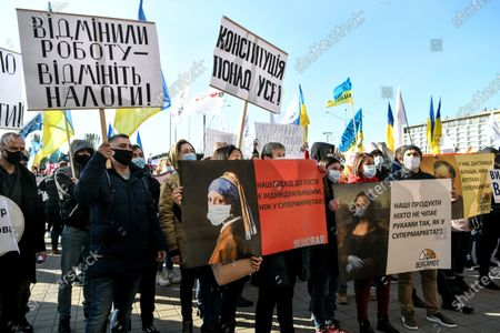 Restaurant and hotel workers protest against the introduction of the weekend lockdown outside the Zaporizhzhia Regional State Administration building, Zaporizhzhia, southeastern Ukraine.