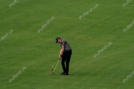 Jimmy Walker hits on the second fairway during a practice round for the Masters golf tournament, in Augusta, Ga