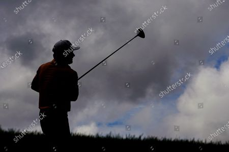 Stock Photo of Graeme McDowell, of Northern Ireland, watches his tee shot from the 18th hole during a practice round for the Masters golf tournament, in Augusta, Ga
