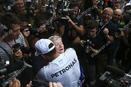 Autodromo Hermanos Rodriguez, Mexico City, Mexico. Sunday 29 October 2017. Lewis Hamilton, Mercedes AMG, celebrates with his mum Carmen Larbalestier, surrounded by photographers and media,after securing his 4th world drivers championship title, and third with Mercedes. World Copyright: Charles Coates/LAT Images