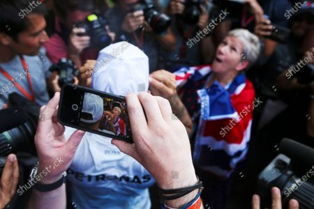 Stock Image of Autodromo Hermanos Rodriguez, Mexico City, Mexico. Sunday 29 October 2017. Lewis Hamilton, Mercedes AMG, celebrates with his mum Carmen Larbalestier, surrounded by photographers and media,after securing his 4th world drivers championship title, and third with Mercedes. World Copyright: Charles Coates/LAT Images