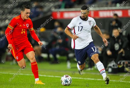 Sebastian Lletget of USA brings the ball forward while under pressure from Connor Roberts of Wales; Liberty Stadium, Swansea, Glamorgan, Wales; International Football Friendly; Wales versus United States of America.