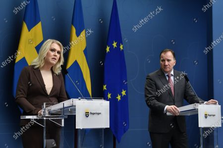 Sweden's Minister for Health and Social Affairs Lena Hallengren (L) and Prime Minister Stefan Lofven give a news conference on new restrictions to curb the spread of the corona (Covid-19) pandemic, in Stockholm, Sweden. The Swedish government proposes a stop for the sale of alcohol after 10 pm from Nov 20 until the end of February.