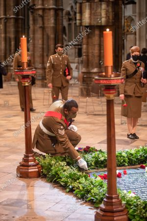 Colour Sergeant Johnson Beharry VC COG and others with their flowers to be laid on the Grave of the Unknown Warrior.