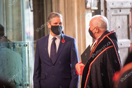 Keir Starmer arrives with mask and Poppy with the The Very Reverend John Hall, The Very Reverend Dr David Hoyle.