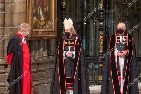 The Archbishop of Canterbury, The Most Reverend and Right Honourable Justin Welby with mask and Poppy. (Centre) with Former Receiver General and Sub The Very Reverend John Hall Abbey.