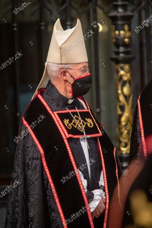 The Archbishop of Canterbury, The Most Reverend and Right Honourable Justin Welby with mask and Poppy.