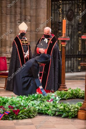 Her Royal Highness Camilla Duchess of Cornwall lays her flowers on the Grave of the Unknown Warrior watched by The Archbishop of Canterbury, The Most Reverend and Right Honourable Justin Welby and The The Very Reverend John Hall, The Very Reverend Dr David Hoyle.